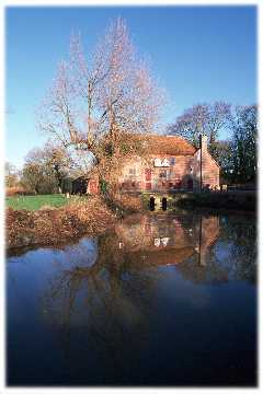The Mill reflected in the tailrace